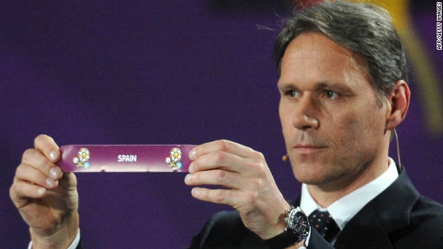 Dutch football legend Marco van Basten holds up the ballot paper of Spain during Friday's Euro 2012 draw in Kiev.