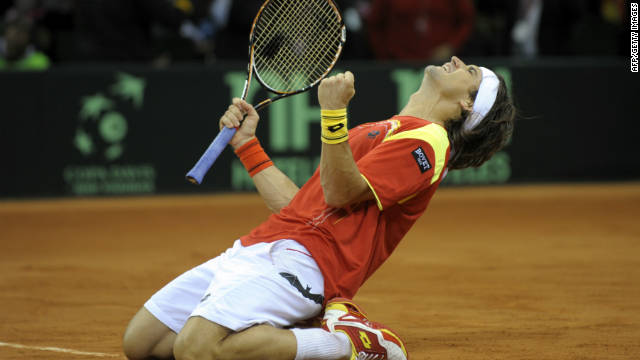 Spain's David Ferrer celebrates after beating Argentina's Juan Martin del Potro at La Cartuja Olympic stadium.
