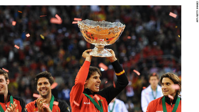 Rafael Nadal holds aloft the Davis Cup trophy after his victory gave Spain the winning point.