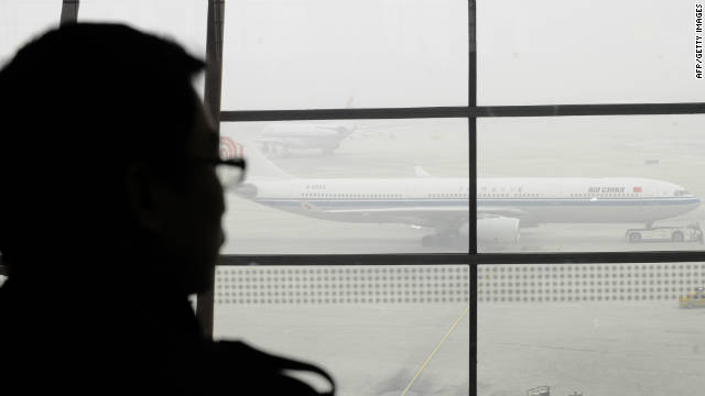Authorities cancel flights as haze shrouds Beijing