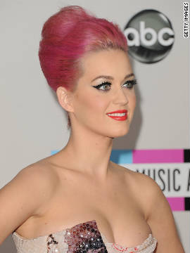 The pop star sports a bright pink updo at the American Music Awards on November 20. Perry was first spotted with bubblegum locks in August. She showed off the wild hue -- with help from some <a href='http://marquee.blogs.cnn.com/2011/08/29/celebs-make-up-for-gagas-tame-vma-look-with-eccentric-outfits/' target='_blank'>unconventional hair accessories</a> -- at MTV's Video Music Awards.