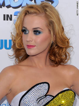 "At the premiere of ""The Smurfs"" movie in New York in July, Perry dons a <a href='http://marquee.blogs.cnn.com/2011/07/25/katy-perry%E2%80%99s-smurf-tastic-look/' target='_blank'>Smurfette dress and nails</a> as well as a lighter ginger hue."