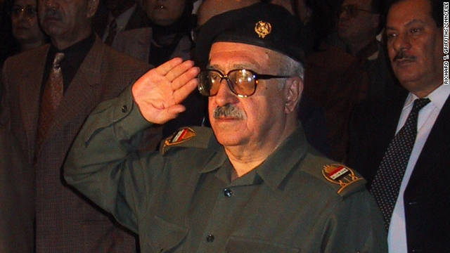 Tariq Aziz salutes the Iraqi national anthem during a 2001 event.