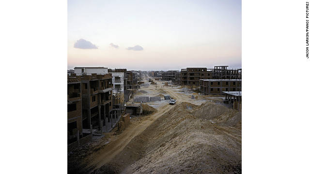 A street of individually owned villas and apartment blocks risesfrom the sand in New Cairo.