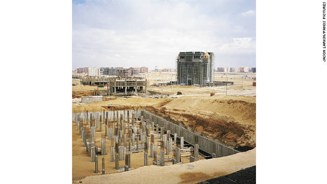 The foundations of a new office building take shape in New Cairo's business district.