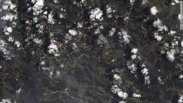 The tiny streaks of brown in this NASA image are in many instances giant <a href='http://edition.cnn.com/2011/WORLD/americas/01/18/brazil.flooding/index.html'>landslides</a> which resulted from flash floods in mountainous terrain 60 kilometers north of Rio de Janeiro in January. They caused at least 900 deaths making it one of the worst natural disasters in Brazil's history, according to the World Meteorological Organization (WMO).