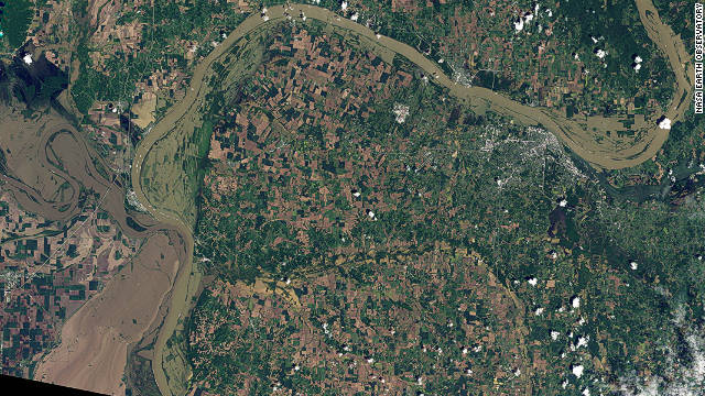 The<a href='http://edition.cnn.com/2011/US/05/21/flooding/index.html'> flooded outline</a> of the Mississippi River can be seen meandering into the left edge of this NASA image, with the Ohio River snaking north and east. Parts of the Mississippi experienced its worst floods since 1933 according to the WMO.