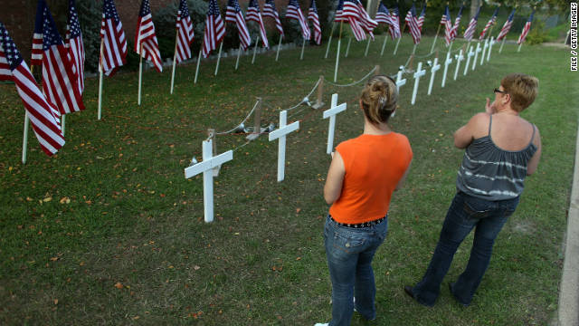 Women look at a temporary memorial in memory of those killed and wounded at Fort Hood, Texas, in 2009.
