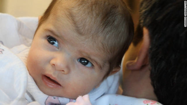 One-month-old Anabella Riley joins her father, John Riley, for a day at Boot Camp for New Dads in Alpharetta, Georgia. John is a recent daddy boot camp graduate. 