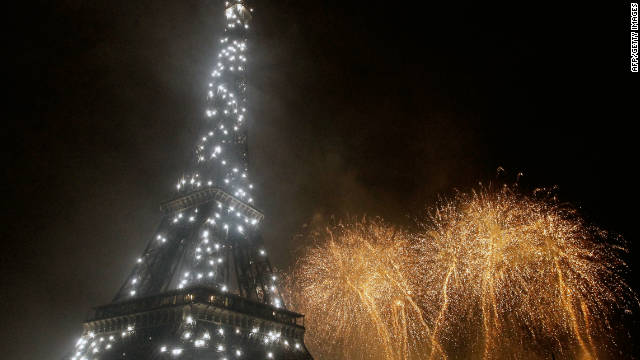 Fireworks burst over the Eiffel Tower, which is itself aglow with lights, during traditional Bastille Day celebrations on July 14, 2011.