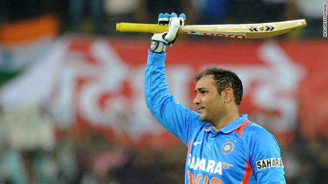 Virender Sehwag celebrates his record double hundred in the one-day international against West Indies.