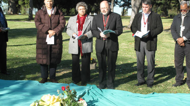 Clergy members offer blessings Wednesday for the unclaimed, cremated remains of 1,639 people who died in 2008.
