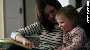 Rosenblatt\'s wife, Alexandra, and their daughter, Harper, read a book together.
