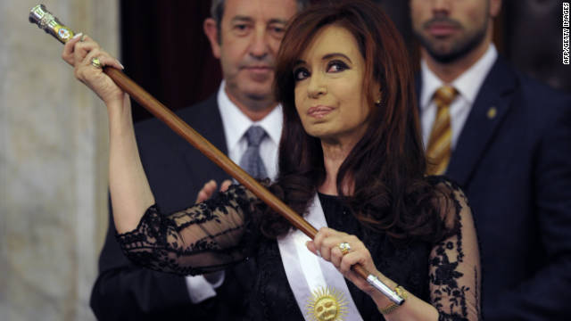 President Cristina Kirchner stands with the presidential sash and stick after her inauguration in Buenos Aires, on Saturday.