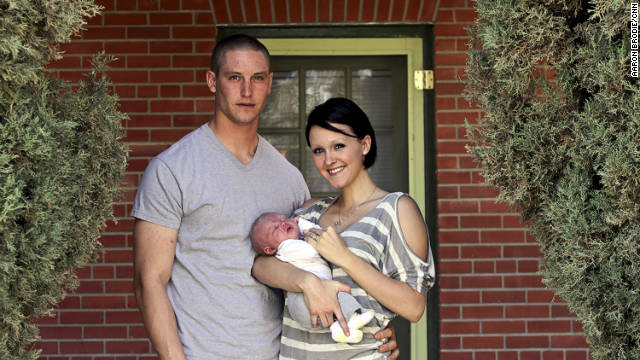 Josh and Sarah, sporting a new hair style and holding Trae, live on base at Fort Bliss. Josh's deployment to Iraq was his first since joining the Army.