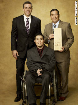 Former NFL quarterback Kurt Warner joins CNN Hero Eddie Canales, founder of &quot;Gridiron Heroes,&quot; and his son.