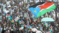 9 July 2011 Thousands of Southern Sudanese wave the flag of their new country during a ceremony in the capital Juba on July 09, 2011 to celebate South Sudan's independence from Sudan.