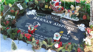 Every year, the Perezes decorate Hernan\'s grave site for Christmas. 