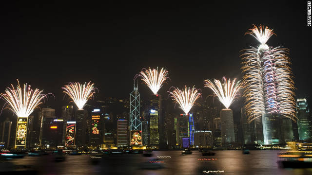 The business district comes to life during New Year's celebration in Hong Kong's Victoria Harbor.