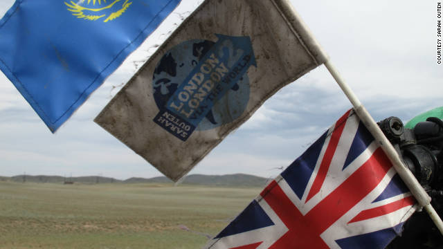 Outen's flags fly high out of her bike kit while cycling into Kazakhstan on May 25, 2011.