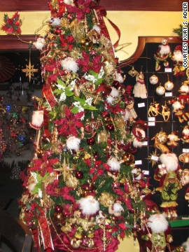 Experiement with different shades of traditional themes, like this burgundy and gold tree.