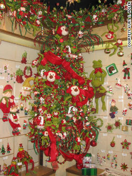Kurt S. Adler's Christmas tree themes range from fun and bright to elegant and sophisticated. This Jolly Elves tree is a great example of using large focal points and different shades of red and green.