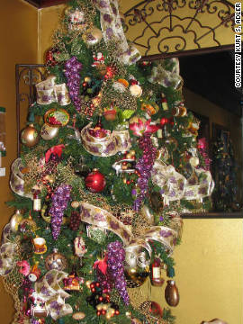 If you're putting up more than one tree, consider a decorator tree in your living room or kitchen, like this Tuscany-themed one.