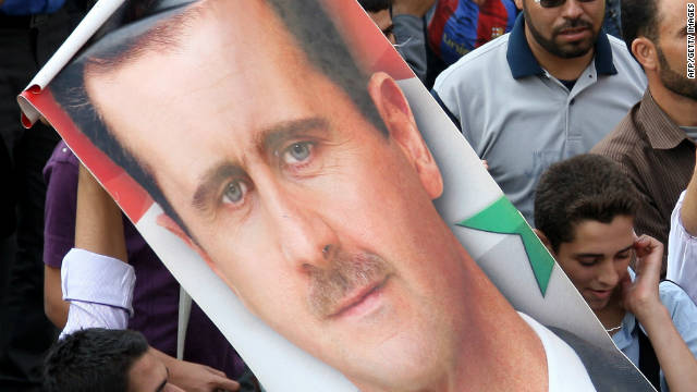 Supporters of Syrian President Bashar al-Assad carry his image through Damascus during a demonstration in October 2011.