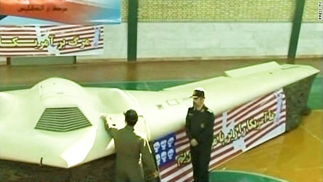 Iranian officials display what they say is an unmanned U.S. spy plane brought down in Iran last week.