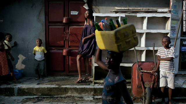 A model poses in the background, in Port Harcourt.