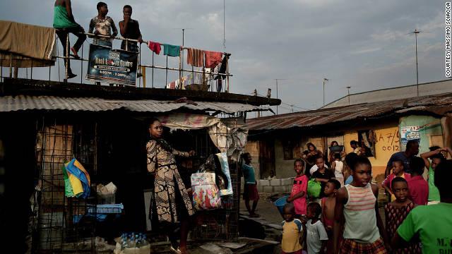 Life in the ghettos goes on around a Kinabuti photo shoot.