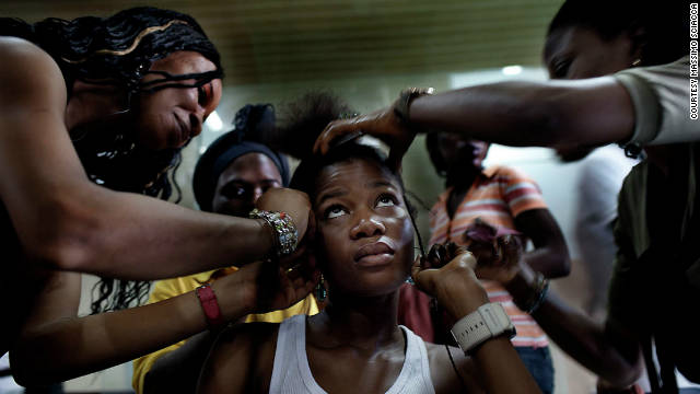 Hair stylists work on a Kinabuti model's hair in the salon.