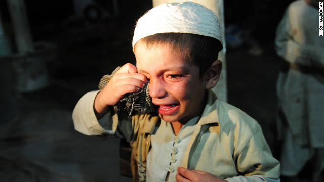 A young boy cries after being rescued by police. Police found the students chained together in the basement of the schoool.
