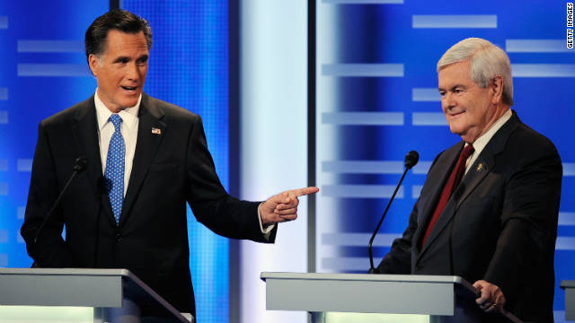 The rivalry in the GOP race is heating up between Mitt Romney and Newt Gingrich, here debating Saturday in Des Moines, Iowa.