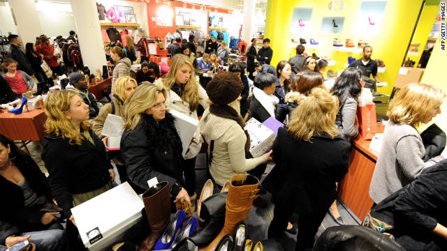 People stand in line to make purchases inside Macy's in New York after the midnight opening to begin 'Black Friday.'
