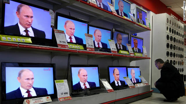TV screens show Prime Minister Vladimir Putin's annual phone-in session with Russians in Moscow.