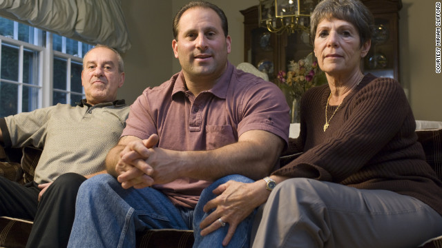 "DiGuglielmo Jr, center, sits with his mother, Rosemarie, and his dad, who said, ""I would wish my son was never there ... my family's torn apart. Literally torn apart."""