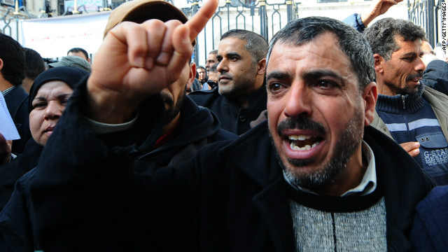 A Tunisian celebrates the dissolution by a Tunisian court of the Rally for Constitutional Democacy (RCD), the former governing party of Tunisia's deposed leader Zine El Abidine Ben Ali, in front of the palace of justice in Tunis after the announcement of the court's ruling on March 09, 2011.