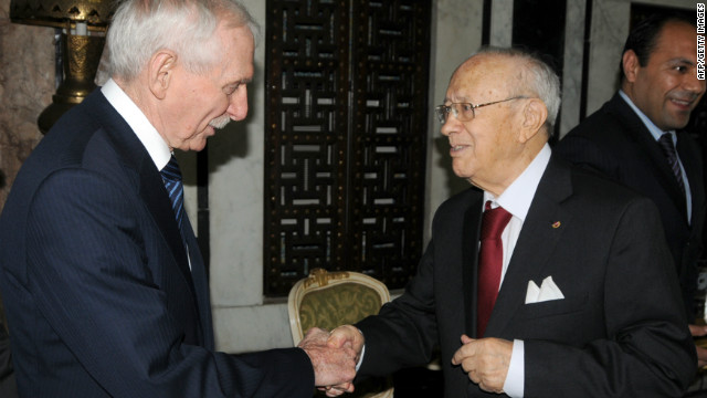 Beji Caid Essebsi, right, is Tunisia's new president-elect. In this 2011 photo, he shakes hands with diplomat William Swing.