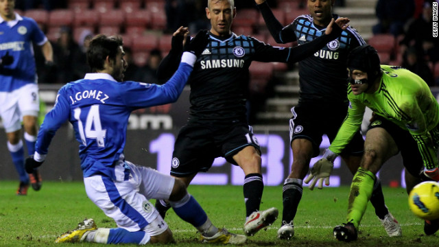Jordi Gomez scores Wigan's equalizer against Chelsea at the DW Stadium on Saturday.