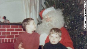 Michael Rielly, left, knew one Santa when he was growing up. But it would be years before he knew it was his \
