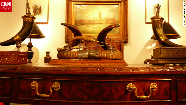 This dresser included Victorian horn ink and desk set (center) and a pair of continental lidded horn vessels with silver mounted figural lids, both expected to bring in between $300 -$500. The Maitland-Smith Chippendale style partners desk upon which they items were situated was priced at $2,000 - $4,000.