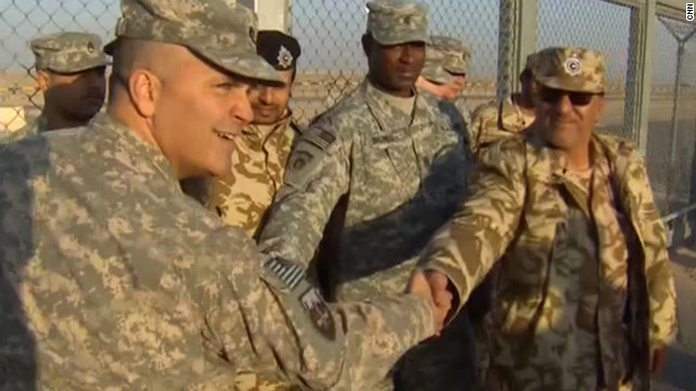 U.S. and Iraqi commanders shake hands to mark the end of the United States' presence in the Iraq combat zone.