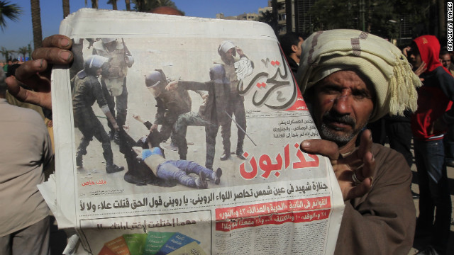 http://i2.cdn.turner.com/cnn/dam/assets/111218115620-egypt-newspaper-woman-beaten-story-top.jpg