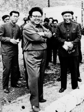 "This Korean Central News Agency photo shows Kim Jong Il with his father, Kim Il Sung, in February, 1992, visiting a mine during an ""on-the-spot"" guidance tour. Kim was named commander in chief of North Korea's military in 1991, and he would succeed his father in 1994 as leader of the country."