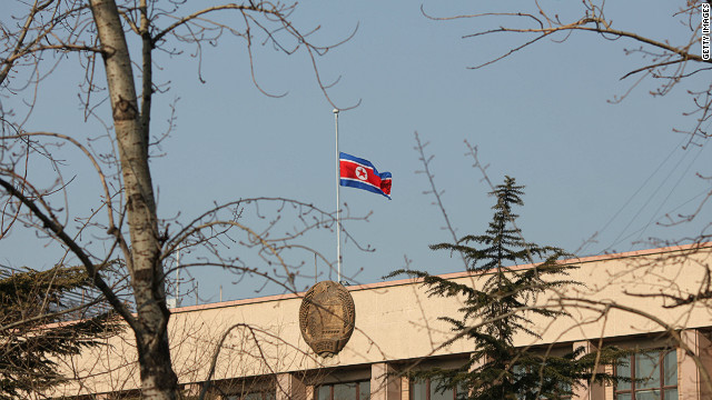 The North Korean flag flies at half-mast above the North Korean embassy in Beijing on December 19, 2011.