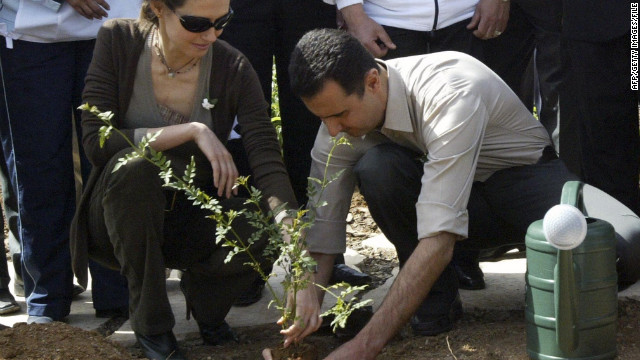 The Syrian first couple plant a jasmine bush in old Damascus in Syria in April 2007.