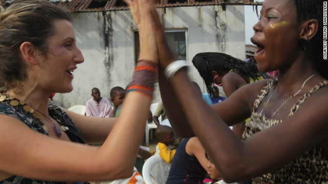 Kinabuti founder Caterina Bortolussi (left) celebrates with Kinabuti model Lizzie during a concert the day after the Kinabuti fashion launch in December 2010.