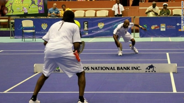World champions past and present Sylvin Barnett, left, and Julian White show off their road tennis skills.