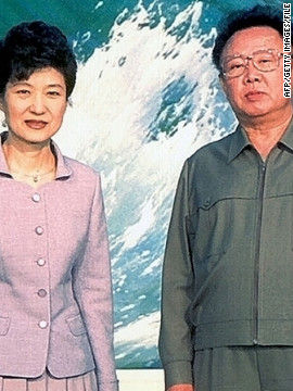 South Korean politician Park Geun-Hye, the daughter of the late military ruler Park Chung-hee, meets with Kim Jong Il on a trip to North Korea in 2002.